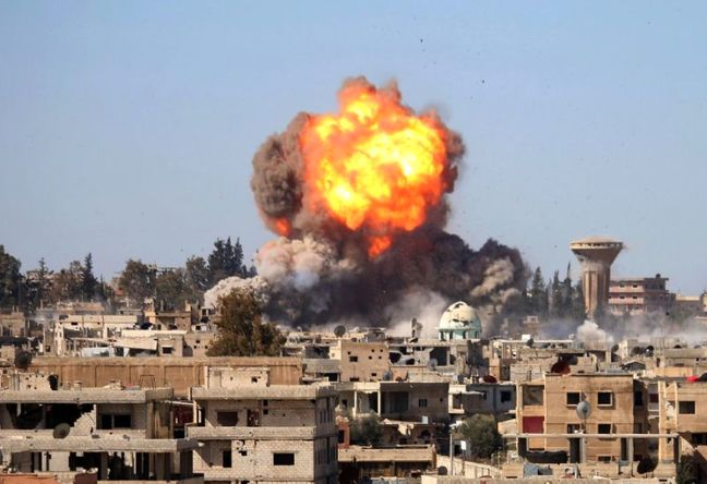 Syrian army and allies step up bombing of rebels in Deraa city