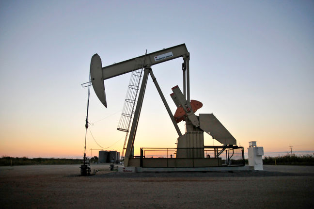 Oil dips on rising U.S. crude inventories, defies expected supply cut extension