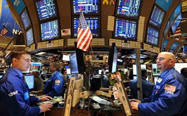 Wall St. edges higher on tech, housing boost