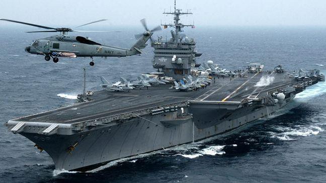 Iran denies harassing U.S. warships in Persian Gulf, warns of clashes
