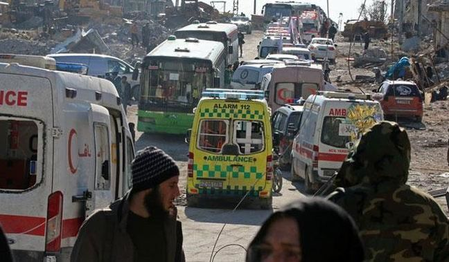 Buses evacuate thousands of exhausted Aleppo residents in ceasefire deal