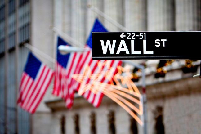 Wall Street opens flat as tech stocks slip