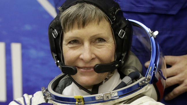 Record-breaking U.S. astronaut and crew back on Earth