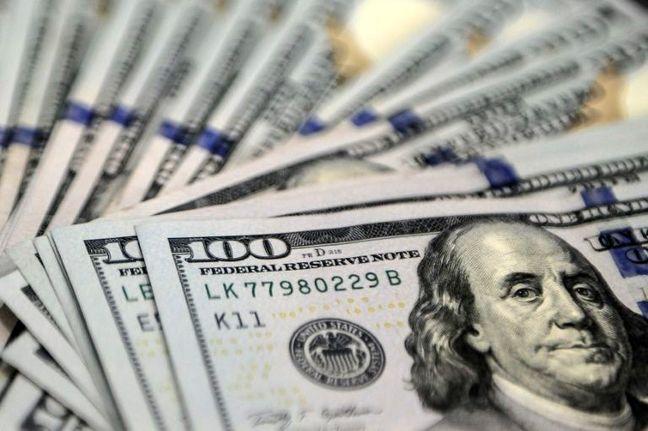 Stocks, dollar under pressure after soft U.S. data