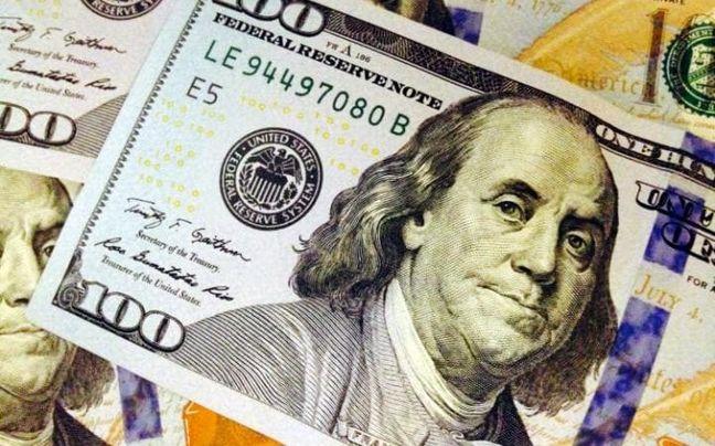 Dollar wavers near highs as investors await Fed this week