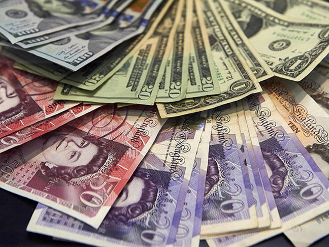 Dollar recovers from two-week lows in holiday-thinned market