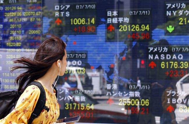 Asia Stocks Mixed While Dollar Weakens Before Fed