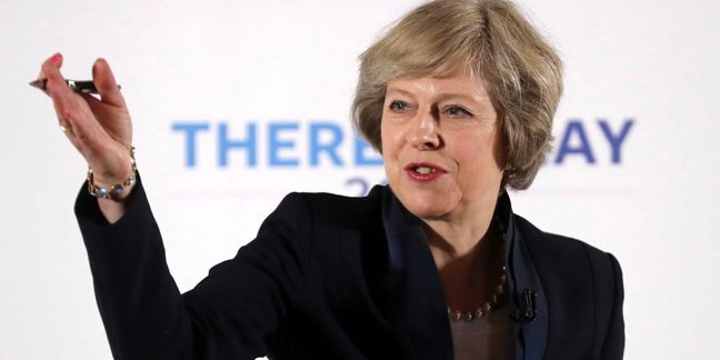 May Faces Rough Ride From France on Brexit If Macron Wins Vote
