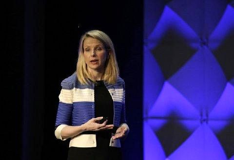 Yahoo beats Wall Street view, sees Verizon deal closing in second quarter