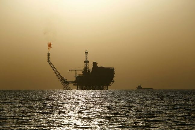 Oil dips on OPEC supply rise, but political risk supports