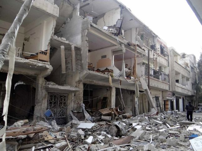 Syrian jets bomb rebel-held eastern Damascus suburbs, dozens killed