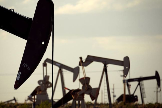 Oil prices rise from one-month lows after OPEC approves strategy