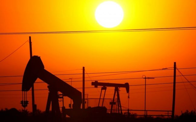 Oil falls close to three-month low as oversupply weighs