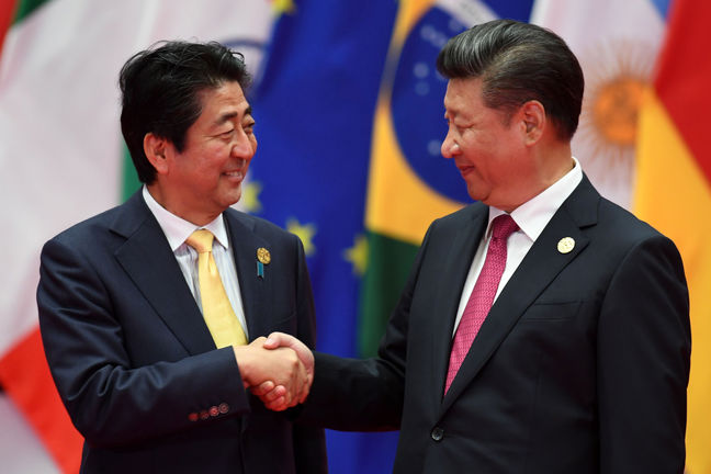 Xi, Abe Get Phone Calls From Trump as North Asia Tensions Rise