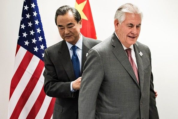 U.S., China soften tone, say to work together on North Korea